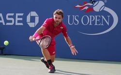 Sep 3, 2016; New York, NY, USA; Stan Wawrinka of Switzerland returns a shot to Daniel Evans of the United Kingdom on day six of the 2016 U.S. Open tennis tournament at USTA Billie Jean King National Tennis Center. Mandatory Credit: Anthony Gruppuso-USA TODAY Sports