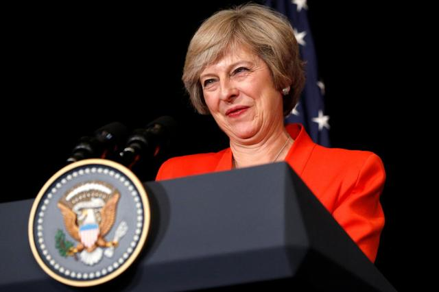 Britain's Prime Minister Theresa May smiles while answering a reporter's question after a bilateral meeting with U.S. President Barack Obama alongside the G20 Summit, in Ming Yuan Hall at Westlake Statehouse in Hangzhou, China September 4, 2016. REUTERS/Jonathan Ernst