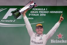Formula One - F1 - Italian Grand Prix 2016 - Autodromo Nazionale Monza, Monza, Italy - 4/9/16 Mercedes' Nico Rosberg celebrates his win on the podium with the trophy Reuters / Max Rossi Livepic