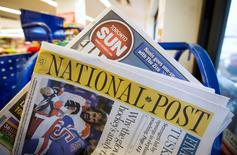 Toronto Sun and National Post newspapers are posed in front of a news stand in Toronto, October 6, 2014.  REUTERS/Mark Blinch