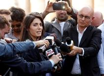 Rome's newly elected mayor Virginia Raggi, of 5-Star Movement, speaks with journalists as she arrives at the Rome's city hall, Campidoglio (Capitoline Hill), downtown Rome, Italy, June 23, 2016. REUTERS/Remo Casilli