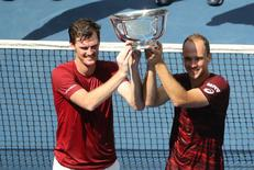 Sep 10, 2016; New York, NY, USA; Jamie Murray of the United Kingdom (left) and Bruno Soares of Brazil display the championship trophy after their win against Pablo Carreno Busta and  Guillermo Garcia-Lopez of Spain in the championship match on day thirteen of the 2016 U.S. Open tennis tournament at USTA Billie Jean King National Tennis Center. Mandatory Credit: Anthony Gruppuso-USA TODAY Sports