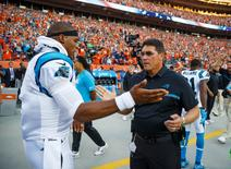 Sep 8, 2016; Denver, CO, USA; Carolina Panthers quarterback Cam Newton (left) greets head coach Ron Rivera prior to the game against the Denver Broncos at Sports Authority Field at Mile High. The Broncos defeated the Panthers 21-20. Mandatory Credit: Mark J. Rebilas-USA TODAY Sports