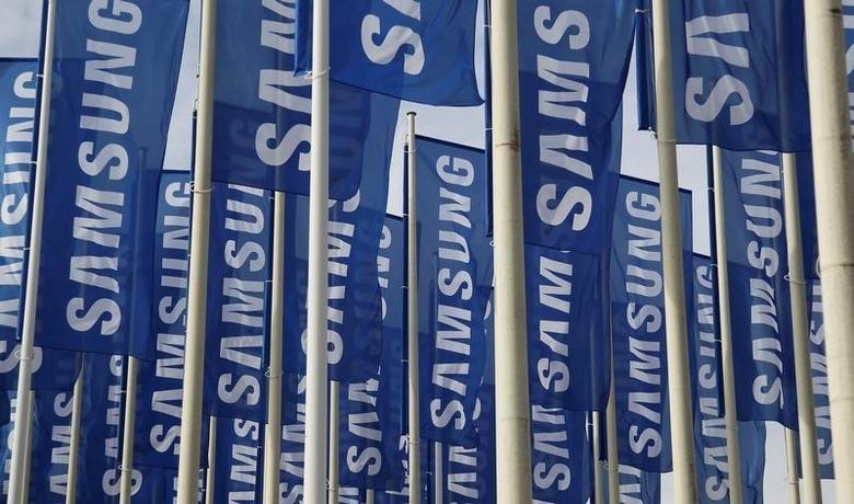 Samsung flags are set up at the main entrance to the Berlin fair ground before the IFA consumer electronics fair in Berlin, August 28, 2012.  REUTERS/Tobias Schwarz/File Photo