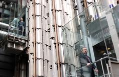 Men ride elevators at the headquarters of Lloyd's of London, in the City of London May 13, 2011. REUTERS/Chris Helgren