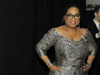 Entertainer Oprah Winfrey poses backstage during the American Theatre Wing's 70th annual Tony Awards in New York, U.S., June 12, 2016. REUTERS/Andrew Kelly -