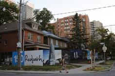 Billboards surround a row of houses set to be demolished to make way for a condominium development feeding the real estate market of Toronto, Ontario, Canada July 3, 2016.  REUTERS/Chris Helgren