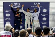 Formula One - F1 - Singapore Grand Prix - Marina Bay, Singapore- 17/9/16  Red Bull's Daniel Ricciardo of Australia, Mercedes' Nico Rosberg of Germany and Mercedes' Lewis Hamilton of Britain celebrate after the qualifying session. REUTERS/Edgar Su