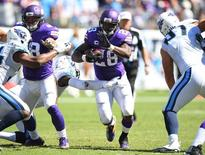 FILE PHOTO - Sep 11, 2016; Nashville, TN, USA; Minnesota Vikings running back Adrian Peterson (28) runs for a short gain during the second half against the Tennessee Titans  at Nissan Stadium. Mandatory Credit: Christopher Hanewinckel-USA TODAY Sports