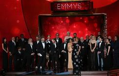 "Executive Producers David Benioff, center left, and D.B. Weiss accept the award for Oustanding Drama Series for ""Game of Thrones"" with the cast and crew at the 68th Primetime Emmy Awards in Los Angeles, California, U.S., September 18, 2016.  REUTERS/Mike Blake"