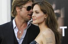 "Cast member Angelina Jolie and actor Brad Pitt attend the premiere of the movie ""Salt"" at the Grauman's Chinese theatre in Hollywood, California July 19, 2010. The movie opens in the U.S. on July 23.  REUTERS/Mario Anzuoni"
