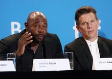 Director Antoine Fuqua and actor Ethan Hawke attend a press conference to promote the film The Magnificent Seven at TIFF the Toronto International Film Festival in Toronto, September 8, 2016.    REUTERS/Fred Thornhill