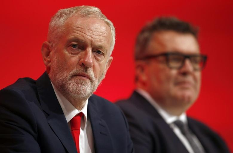 The Leader of Britain's opposition Labour Party, Jeremy Corbyn (L), and deputy leader, Tom Watson, listen to a speech on the first day of the Labour Party conference, in Liverpool, Britain September 25, 2016.  REUTERS/Peter Nicholls