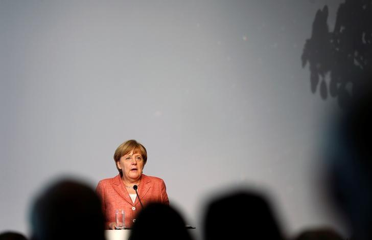 German Chancellor Angela Merkel delivers a speech at a summit of the Federal Association of the German Tourism Industry (BTW) at the Adlon Hotel in Berlin, Germany, September 26, 2016. REUTERS/Hannibal Hanschke