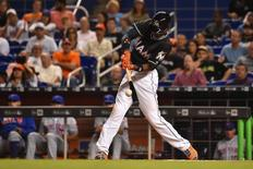 Sep 26, 2016; Miami, FL, USA; Miami Marlins second baseman Dee Gordon connects for his fourth hit of the game against the New York Mets at Marlins Park. Mandatory Credit: Jasen Vinlove-USA TODAY Sports