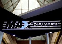 A MAXpower sign is seen above the power company's booth at an electricity exhibition show at the convention center in Jakarta, Indonesia September 28, 2016. REUTERS/Darren Whiteside