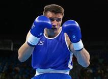 Boxeador olímpico britânico Antony Fowler durante competição na Rio 2016.    08/08/2016       REUTERS/Peter Cziborra