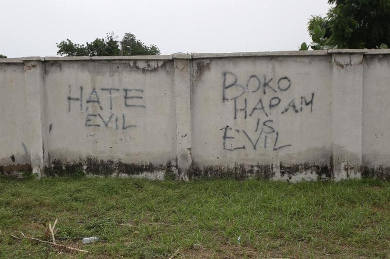 Writings describing Boko Haram are seen on the wall along a street in Bama, in Borno, Nigeria August 31, 2016. REUTERS/Afolabi Sotunde