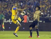 Football Soccer - Tigres v Pumas - The first leg of their Mexican first division final soccer match - Universitario stadium, Monterrey, Mexico - 10/12/15 Tigres' Guido Pizarro battles for the ball against Javier Cortes of Pumas. REUTERS/Daniel Becerril