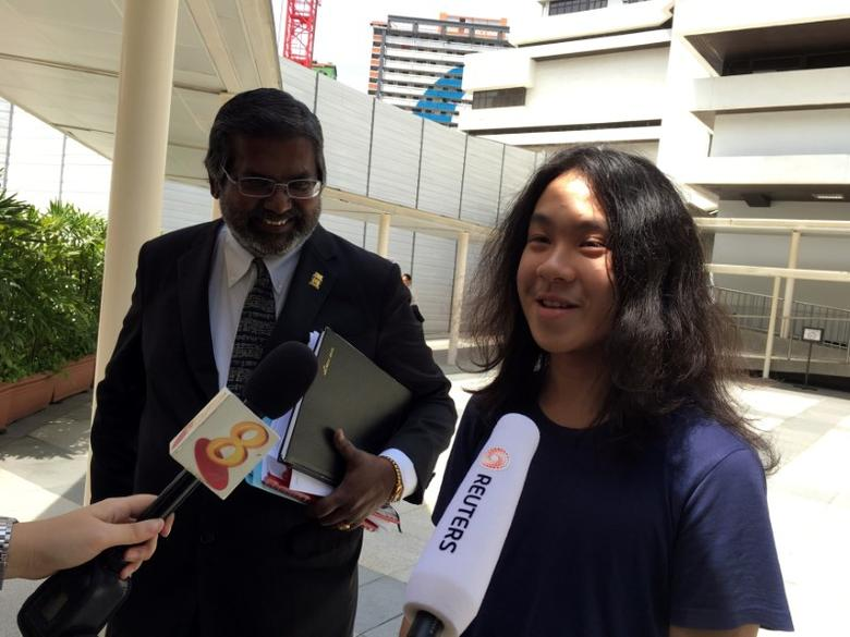 Teen blogger Amos Yee speaks to reporters next to lawyer Nadarajan Kanagavijayan, after hearing his verdict, while leaving the State Courts in Singapore September 29, 2016. REUTERS/Pedja Stanisic