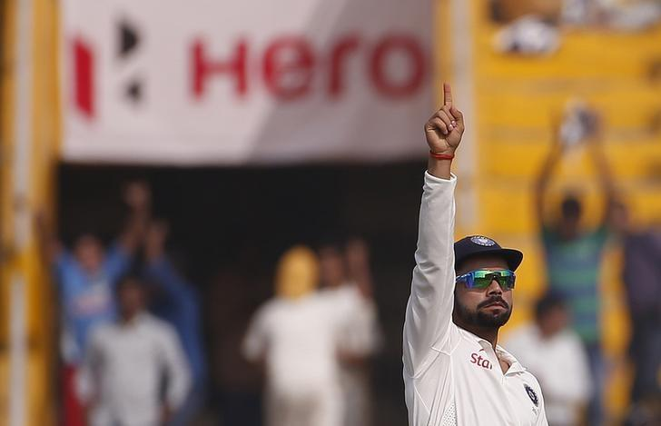 India's captain Virat Kohli celebrates the dismissal of South Africa's AB de Villiers (not pictured) during the third day of their first cricket test match, in Mohali, India, November 7, 2015. REUTERS/Adnan Abidi/Files