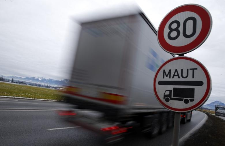 A truck passes a sign for Germany's truck road toll system ''Maut'' in Rosenheim, southern Germany, January 25, 2016. REUTERS/Michael Dalder