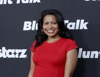 """Courtney Kemp Agboh, creator and showrunner of the television series """"Power,"""" poses during Los Angeles premiere of """"Blunt Talk"""" at the DGA Theater in Los Angeles, California August 10, 2015. REUTERS/Kevork Djansezian"""