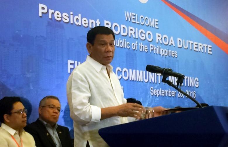Philippines' President Rodrigo Duterte speaks at a Filipino Community Meeting in Hanoi, Vietnam September 28, 2016. REUTERS/Martin Petty