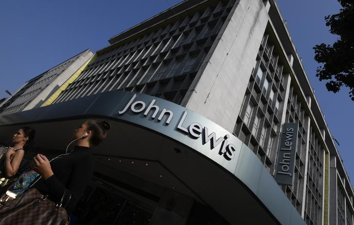 Shoppers pass a branch of John Lewis in London, Britain, September 15, 2016. REUTERS/Toby Melville