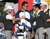 Sep 29, 2016; Chaska, MN, USA;  Rory McIlroy of Northern Ireland greets  Andy Sullivan of England on the first tee during a practice round for the 41st Ryder Cup at Hazeltine National Golf Club. Mandatory Credit: Michael Madrid-USA TODAY Sports