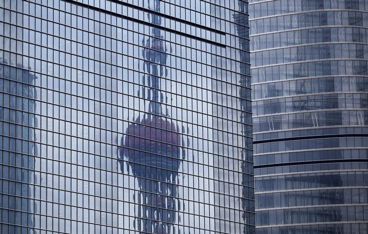 The Oriental Pearl TV Tower reflected on the facade of another building at Pudong financial district in Shanghai April 2, 2014. REUTERS/Carlos Barria/Files