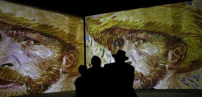 People look at the works of Vincent Van Gogh, projected on the wall during the opening exhibition ''Van Gogh. Revived paintings'' in Minsk, Belarus  November 12, 2015. REUTERS/Vasily Fedosenko/Files