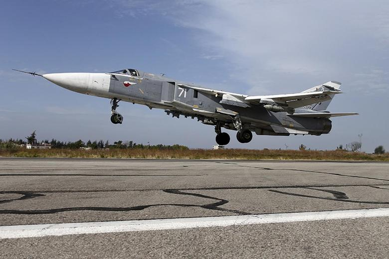 A Sukhoi Su-24 fighter jet takes off from the Hmeymim air base near Latakia, Syria, in this handout photograph released by Russia's Defence Ministry on October 22, 2015. REUTERS/Ministry of Defence of the Russian Federation/Handout via Reuters