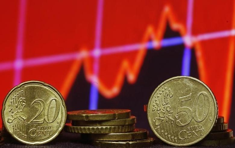Euro coins are seen in front of displayed stock graph in this picture illustration taken in Zenica, March 13, 2015. REUTERS/Dado Ruvic