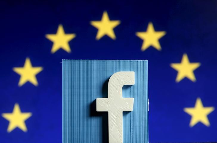 A 3D-printed Facebook logo is seen in front of the logo of the European Union in this picture illustration made in Zenica, Bosnia and Herzegovina on May 15, 2015.   REUTERS/Dado Ruvic/Files