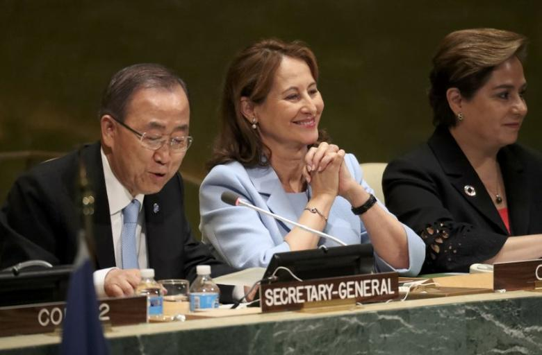French Minister for Environment Segolene Royal (C) looks on as U.N. Secretary General Ban Ki-moon (L) concludes a ''High-Level Event on Entry into Force of the Paris Agreement on Climate Change'' meeting at United Nations headquarters in the Manhattan borough of New York, U.S., September 21, 2016.  REUTERS/Carlo Allegri