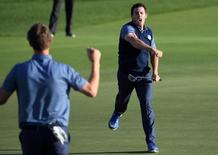 Sep 30, 2016; Chaska, MN, USA;  Rory McIlroy of Northern Ireland celebrates winning his match on the 16th green in the afternoon four-ball matches during the 41st Ryder Cup at Hazeltine National Golf Club. Mandatory Credit: Michael Madrid-USA TODAY Sports