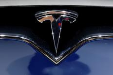 A Tesla logo is seen on media day at the Paris auto show, in Paris, France, September 30, 2016. REUTERS/Benoit Tessier