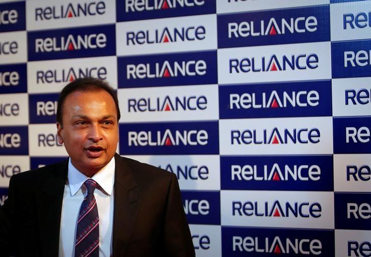 Anil Ambani, chairman of the Reliance Anil Dhirubhai Ambani Group, poses for photographers before addressing the annual shareholders meeting in Mumbai August 27, 2013. REUTERS/Danish Siddiqui/File Photo