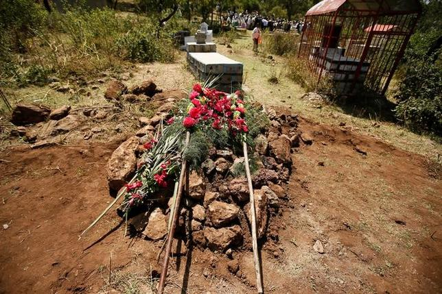 Fresh flowers are pictured on the grave of Tesfu Tadese Biru, 32, a construction engineer who died during a stampede after police fired warning shots at an anti-government protest in Bishoftu during Irreecha, the thanksgiving festival of the Oromo people, in Denkaka Kebele, Ethiopia, October 3, 2016. REUTERS/Tiksa Negeri