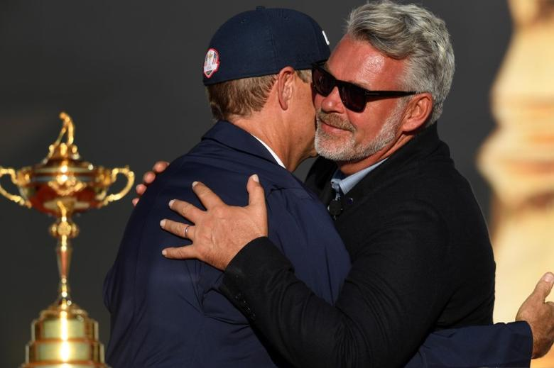 Oct 2, 2016; Chaska, MN, USA; Team Europe captain Darren Clarke and Team USA captain Davis Love III hug during the closing ceremonies after the single matches in 41st Ryder Cup Hazeltine National Golf Club. Mandatory Credit: Michael Madrid-USA TODAY Sports