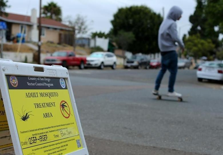 Signs are placed around a neighborhood as county vector control hand-spray a  for adult Aedes mosquitoes after a travel-related case of Zika was confirmed in this the area of San Diego, California, U.S. September 12, 2016. REUTERS/Mike Blake