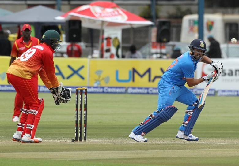Cricket - Second One Day International - India v Zimbabwe - Harare, Zimbabwe - 13/06/16. India's Karun Nair (R) plays a shot as Zimbabwe's wicket keeper Richmond Mutumbami looks on. REUTERS/Philimon Bulawayo