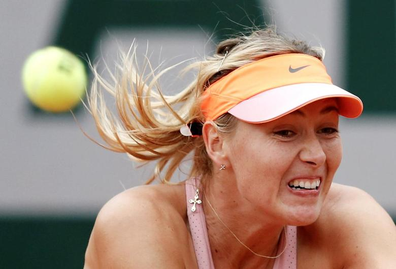 Maria Sharapova of Russia competes against Samantha Stosur of Australia in their women's singles match at the French Open tennis tournament at the Roland Garros stadium in Paris June 1, 2014.        REUTERS/Vincent Kessler/File Photo
