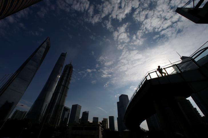 A man walks on a bridge in the financial district of Pudong in Shanghai, China June 22, 2016. REUTERS/Aly Song/Files