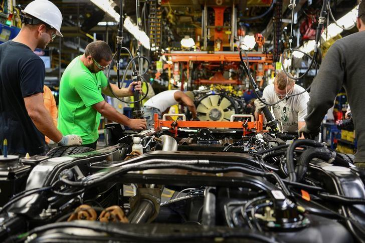 Workers assemble a Ford truck at the new Louisville Ford truck plant in Louisville, Kentucky, U.S. September 30, 2016.  REUTERS/Bryan Woolston