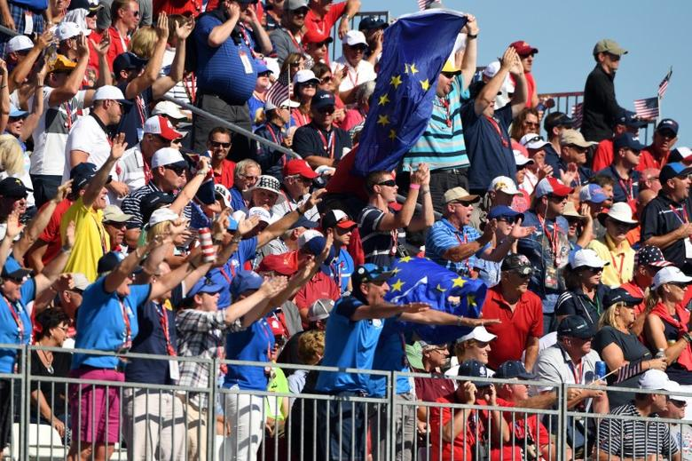 Oct 2, 2016; Chaska, MN, USA; Fans cheer on the ninth green during the single matches in 41st Ryder Cup at Hazeltine National Golf Club. Mandatory Credit: John David Mercer-USA TODAY Sports