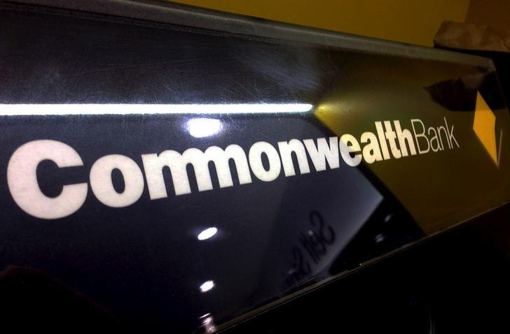 A Commonwealth Bank of Australia logo adorns the wall of a branch in Sydney, Australia, November 5, 2015. REUTERS/David Gray/File Photo