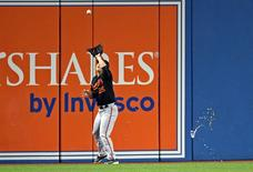 Oct 4, 2016; Toronto, Ontario, CAN; Baltimore Orioles left fielder Hyun Soo Kim (25) catches a fly ball as a fan throws object on the field during the seventh inning against the Toronto Blue Jays in the American League wild card playoff baseball game at Rogers Centre. Mandatory Credit: Nick Turchiaro-USA TODAY Sports