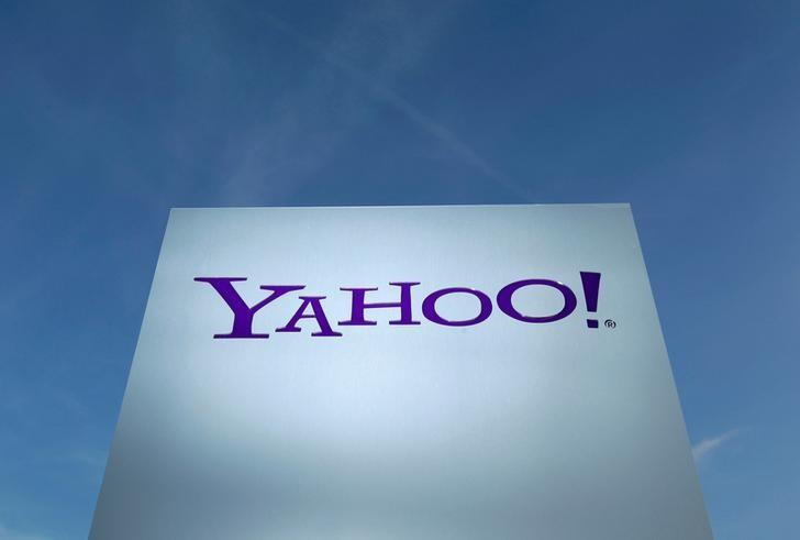 A Yahoo logo is pictured in front of a building in Rolle, Switzerland December 12, 2012. REUTERS/Denis Balibouse/Files